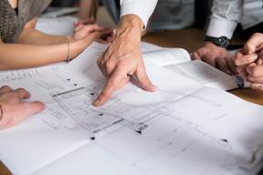 Coop buyers looking at a floorplan