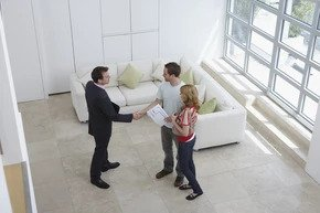 broker showing a coop apartment to potential clients in NYC