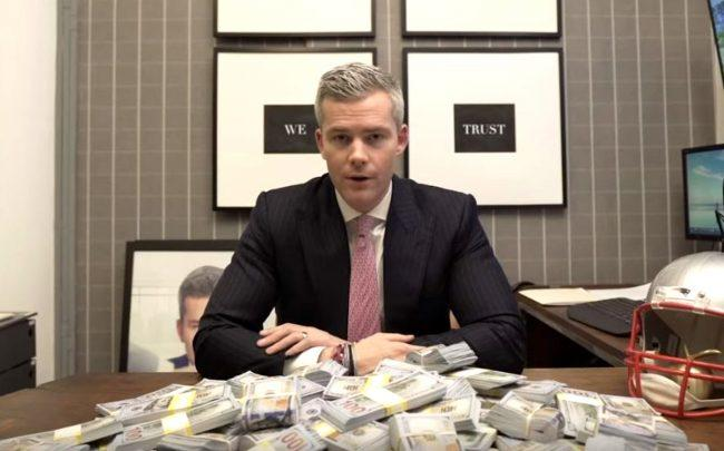 Ryan Serhant money in front of a pile of cash
